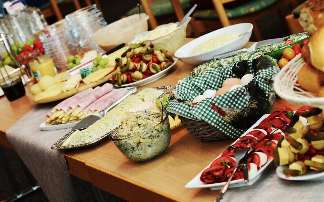 A photo of a table spread with food